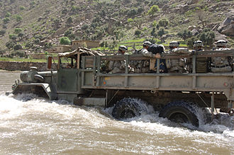 M809 series 5-ton 6x6 truck - M813 crossing a river
