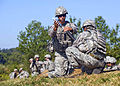 Defense.gov News Photo 100831-A-3843C-197 - U.S. Army Pfc. Joseph Guzman 1st Battalion 181st Infantry Regiment prepares to drop a 60mm mortar to launch at fixed targets at Camp Atterbury.jpg