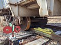 Derailed train car and locked derailer.jpeg