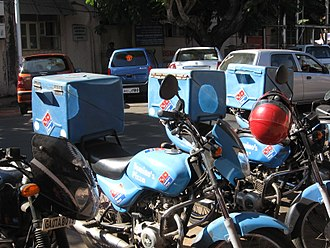 Pizza box - Domino's Pizza motor bikes that are used for pizza home delivery in Goa, India, with transport boxes mounted atop