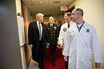President Donald J. Trump talks with, from left to right, with Capt. Mark Kobelja, Director of Walter Reed National Military Medical Center; Dr. Ronny Jackson, Physician to the President; and Dr. James Jones, physical to the President and Medical Director of the Medical Evaluation and Treatment Unit, Friday January 12, 2018, in Bethesda, MD, following the President's annual physical at the medical facility.