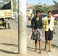 Dressed up ladies walking in a dusty street.jpg