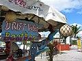 Driftwood Boat Bar at Maho Beach (6543920129).jpg