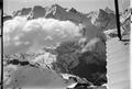 ETH-BIB-Blümlisalp mit Wolken, Oeschinensee v. W. aus 3600 m-Inlandflüge-LBS MH01-000446.tif