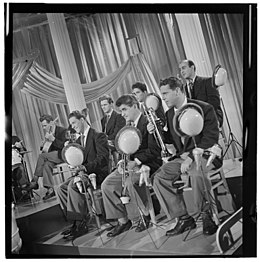 Emil Terry, Lou Mucci, Eddie Zandy, Barry Galbraith, Bill Barber, Al Langstaff, and Vahe Takvorian, Columbia Pictures studio, New York, ca. Sept. 1947 (William P. Gottlieb 08581).jpg
