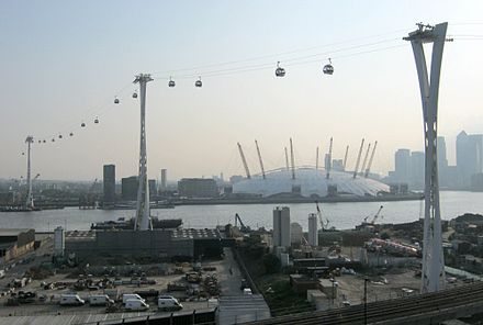 The Emirates Air Line crosses the River Thames between Greenwich Peninsula and the Royal Docks Emirates Air Line towers 24 May 2012.jpg