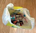 Empty recyclable beverage containers in plastic bag.jpg