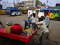 Extraction of sugar cane juice at the Mandla bus station.jpg