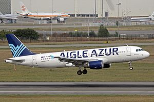 Aigle Azur - An Airbus A320 in the airline's new livery landing at Toulouse Blagnac International Airport (September 2013).