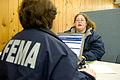 FEMA - 40068 - FEMA IA worker helps a resident in Washington.jpg