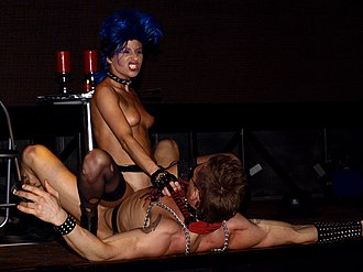 Dominatrix - A professional dominatrix and a submissive male perform for the audience at a sex show in Austria.