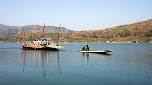 Na Muen District - The ferry over the Nan River Reservoir, created by the Sirikit Dam, connecting the village of Pak Tai in Na Muen District with the southern shore