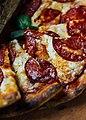 Few pizza slices closeup (49426367452).jpg