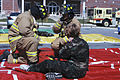 Fire Fighters Jason Collier and Anthony Shreve aid a casualty of a simulated tornado played by Civil Air Patrol, Michigan Wing member.jpg