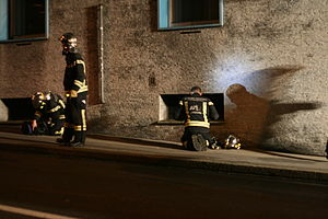 Firemen during a night fire in Lausanne