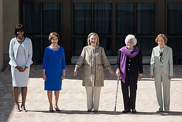 United States First Lady Michelle Obama with former First Ladies Laura Bush, Hillary Clinton, Barbara Bush, and Rosalynn Carter during the dedication of the George W. Bush Presidential Library and Museum on the campus of Southern Methodist University in Dallas, Texas, on 25 April 2013. As of March 6, 2016, these are all five of the living current and former First Ladies of the United States.