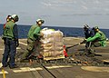 Flickr - Official U.S. Navy Imagery - Sailors aboard USS Taylor move stores during a replenishment at sea..jpg