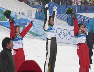 Freestyle skiing at the 2010 Winter Olympics – Women's aerials - Image: Flower ceremony for Womens Aerials adjusted