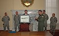 Formerly deployed reservists present U.S. flag to Alabama governor.jpg
