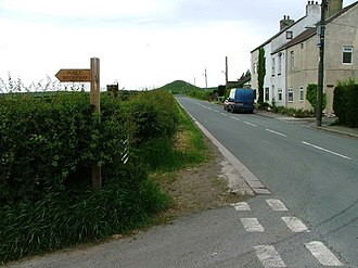 Moorsholm - The road south out of Moorsholm, with Freebrough Hill visible in the distance, Moorsholm Moor lies further south