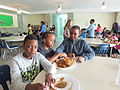 Friends Share Their Injera.JPG
