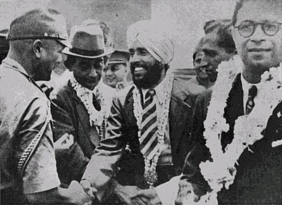 Major Iwaichi Fujiwara greets Mohan Singh, leader of the First Indian National Army. Circa April 1942. Fujiwara Kikan.jpg