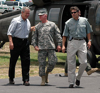 McAllen Miller International Airport - President George W. Bush is greeted at MFE by U.S. Army Lt. Gen. H Steven Blum and Texas Governor Rick Perry on August 3, 2006. Bush was visiting troops participating in Operation Jump Start.