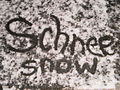 German translation 'Schnee' written in snow for Wiktionary and Wikipedia W 15 on sidewalk in Marburg-Ockershausen 2016-01-14.JPG