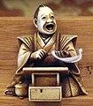 Giappone, periodo edo, netsuke (fermaglio per inroo), xix secolo, 129 oratore.jpg
