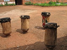 four drums in courtyard