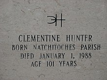 Inscription on gravestone reads. Distinctive signature, backwards C interlocking with H. Clementine Hunter, Born Natchitoches Parish, Died January 1, 1988, Age 101 Years.