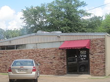 Grayson Barbeque in Clarence, with a smokehouse, draws clientele from beyond the village because of its regional reputation and location on U.S. Highway 71 near the intersection with U.S. Highway 84.