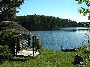 """Grey Owl - Grey Owl's cabin """"Beaverlodge"""", Ajawaan Lake"""