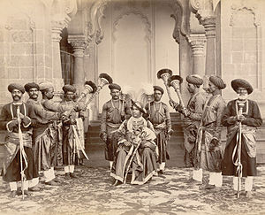 Shahu of Kolhapur - H.H. Shahu Chhatrapati Maharaj seated with palace servants