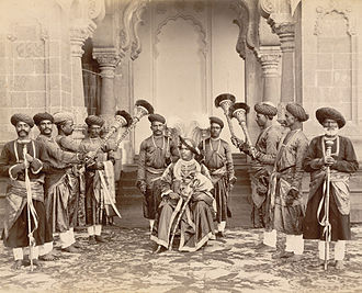 Shahu of Kolhapur - H.H. Shahu Chhatrapati Maharaj seated with palace servants