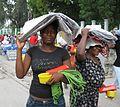 Haitians receive USAID shelter kits (4425593456).jpg