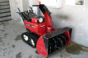 Snow blower - A heavy-duty walk-behind two-stage snow blower.