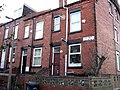 Houses on the corner of Back Burchett Place and Hartley Avenue, Woodhouse, Leeds (2009) - panoramio.jpg