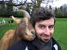 Dr Christian Nawroth is a scientist that studies animal cognition and is pictured with one of his goats.