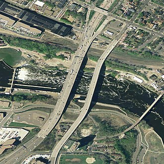 I-35W Mississippi River bridge - I-35W bridge (center left) west of the 10th Avenue Bridge (center right), 2004