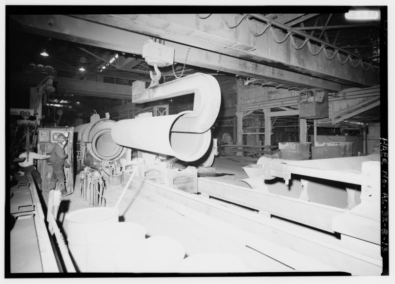 File:INTERIOR VIEW WITH LARGE PIPE CASTING MACHINE AND BRIDGE CRANE PICKING UP A 48' PIPE FOR WEIGHING AND TRANSFER TO ANNEALING OVEN. - United States Pipe and Foundry Company Plant, HAER ALA,37-BES,6B-13.tif