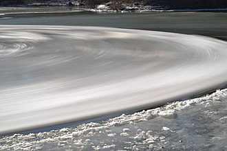 Ice circle - A long exposure image showing the rotation of the large ice circle on the Esopus Creek in New York