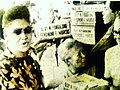 Imelda Marcos at a food doleout event during the waning days of the Marcos dictatorship.jpg