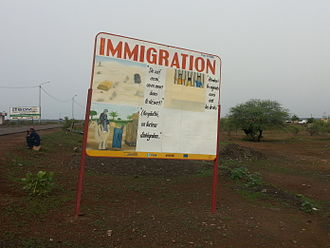 Immigration - Sign Immigration near the border between Mali and Mauritania; sponsored by EU