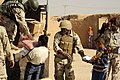 Iraqi locals receive food DVIDS321536.jpg