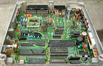 JECS - Mid 1980s JECS LH-Jetronic ECU. 40 pin IC bottom left is Hitachi Motorola 6800 clone, 28 pin IC (socketed) immediately right is 16kB ROM containing maps. JECS logo bottom left.
