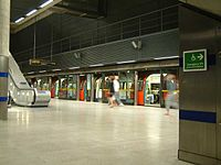 Jubilee Line train stopped at Canary Wharf underground station - London - 240404.jpg