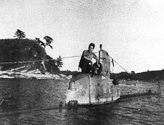 Moroiso - An American soldier on a Kairyu submarine at the entrance of Moroiso inlet, December 1945.