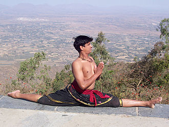 Split (gymnastics) - A front split in yoga; the pose is named Hanumanasana.