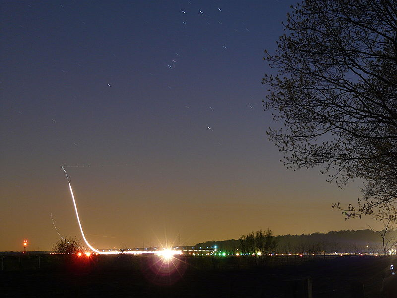Night shot from 2 F16's at Kleine Brogel. One minute opening. The first started with afterburner, the second without, in the background you can see another plane too.  It's nice to see how much the stars moved in one minute
